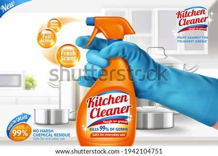 3d kitchen cleaner spray ad template. Realistic orange spray bottle held in hand on blurry white kitchen counter background.