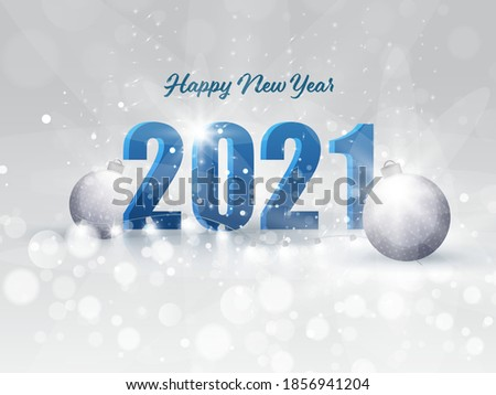 3D 2021 Number with Baubles and Bokeh Effect on Falling Snow Grey Background.