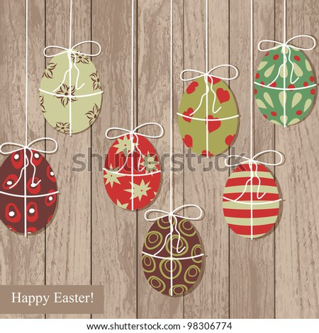 Easter eggs on wooden texture.