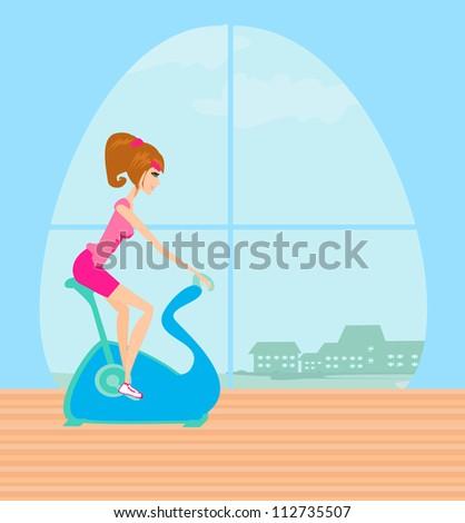 Girl on the exercise bike