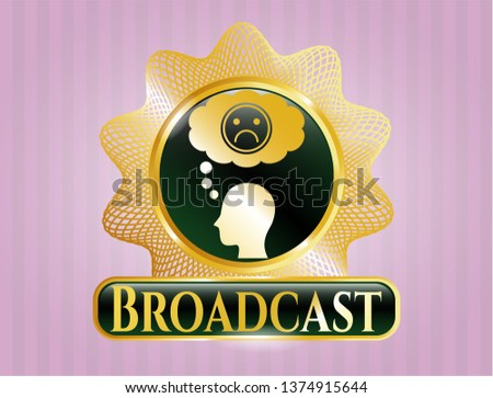 Gold badge or emblem with depression icon and Broadcast text inside