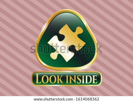 Gold badge or emblem with jigsaw puzzle piece icon and Look inside text inside