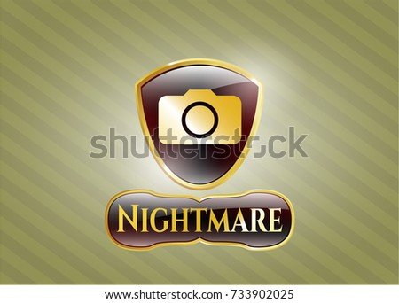 gold badge or emblem with