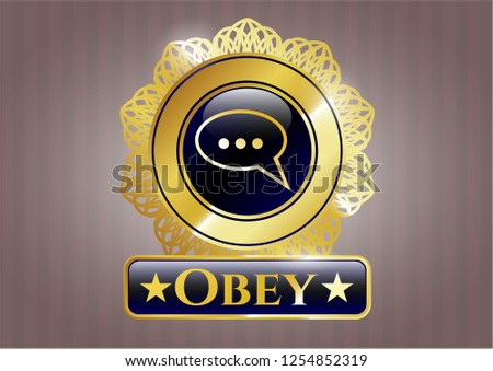 Gold badge with speech bubble icon and Obey text inside
