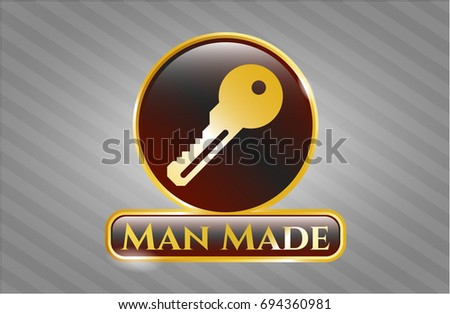 gold emblem or badge with key