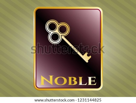 Gold emblem or badge with key icon and Noble text inside