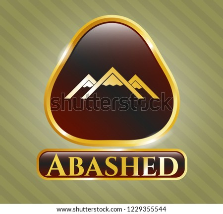 Gold emblem with mountain icon and Abashed text inside Сток-фото ©