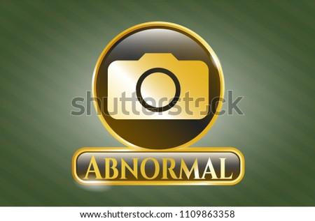 gold emblem with photo camera