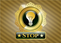 Gold shiny emblem with light bulb icon and Stop text inside