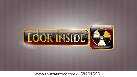 Golden emblem or badge with nuclear, radioactive icon and Look inside text inside
