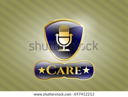 golden emblem with microphone