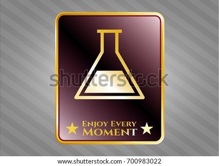 golden emblem with test tube