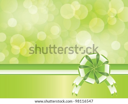 Green background with bow   and blurry light