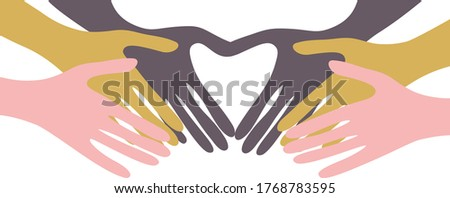 Hands of different colors stretch to each other and form a heart. The idea of unity of peoples of races and nationalities. The concept of love and kindness all over the world. Photo stock ©
