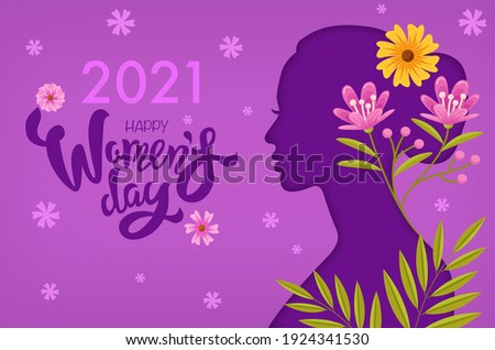 2021 Happy Women's Day, purple silhouetted woman in side profile with flowers in her hair. Stock fotó ©
