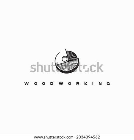 illustration consisting of an image of a piece of wood and the inscription 'woodworking' in the form of a symbol or logo 商業照片 ©