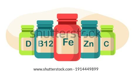5 jars of dietary supplements with iron, zinc, vitamin D, vitamin b12, vitamin C. Health care concept.