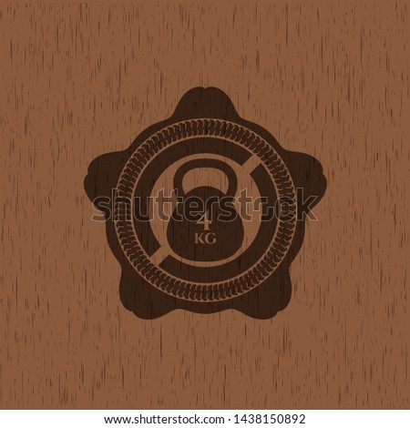 4kg kettlebell icon inside badge with wooden background