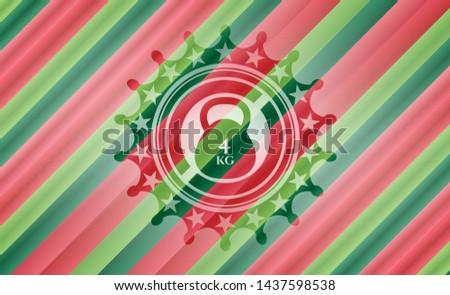4kg kettlebell icon inside christmas emblem.