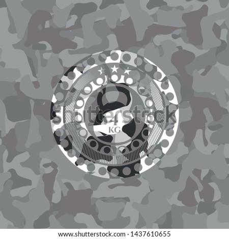 4kg kettlebell icon inside grey camouflaged emblem