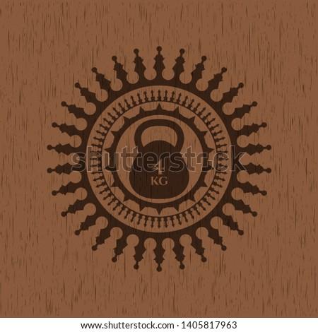 4kg kettlebell icon inside wooden emblem. Retro