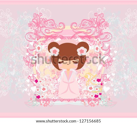 kokeshi doll on the pink