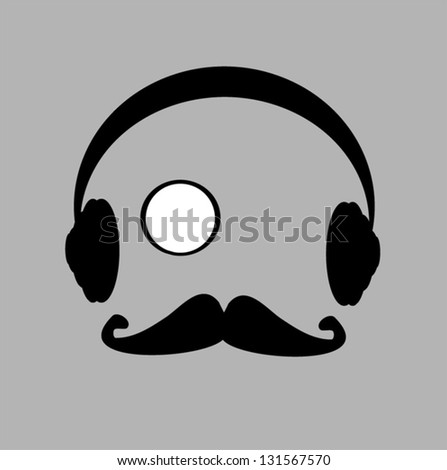 man with monocle and headphones