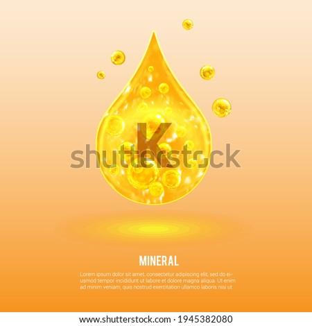 Mineral K. Potassium. Kalium. Mineral Vitamin complex. Golden drop and golden balls. Health concept. K Potassium.  Stock fotó ©