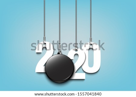 2020 new year and hockey puck