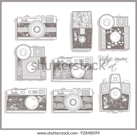 Retro photo cameras set. Vector illustration. Vintage cameras with flowers. Camera with floral pattern.