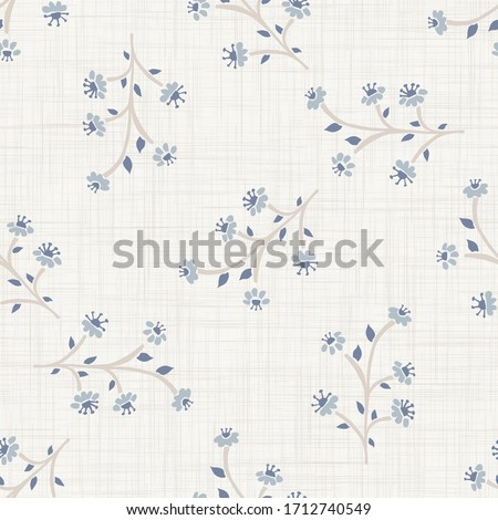 Seamless herb floral pattern in french blue linen shabby chic style. Hand drawn country bloom texture. Rustic woven background. Kitchen towel home decor swatch. Simple flower motif all over print Foto stock ©