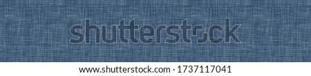Seamless indigo blue woven linen texture pattern. Denim worn out weave style background. Decorative irregular acid wash japanese boro all over print. Fabric grunge canvas textile effect cloth swatch. Stockfoto ©