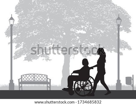 Silhouette of a woman who is in a wheelchair.