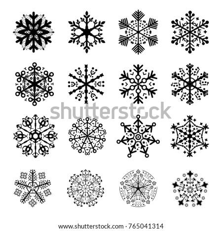 16 silhouettes of snowflakes