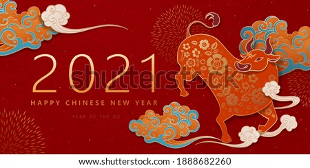 2021 Traditional paper art style imposing bull with auspicious clouds over red banner background