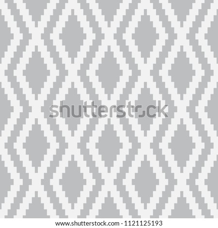 Vector seamless pattern. Modern stylish texture. Repeating geometric tiles with a grid of rhombuses.