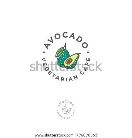 ¬Vegetarian restaurant logo. Avocado cafe emblem. Avocado icon. Avocado one cut in half with bone and a whole avocado with a leaf in a circle.