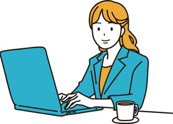 Woman working on laptop computer at company