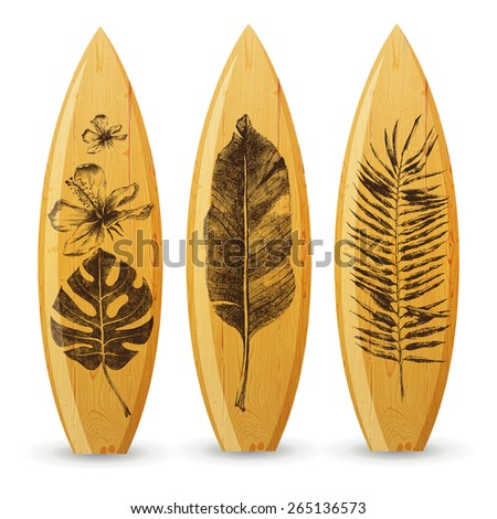3 wooden surfboards with hand