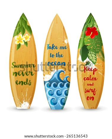 3 wooden surfboards with prints