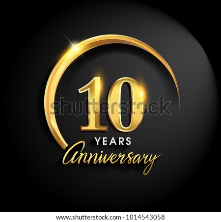 10 years anniversary celebration. Anniversary logo with ring and elegance golden color isolated on black background, vector design for celebration, invitation card, and greeting card ストックフォト ©