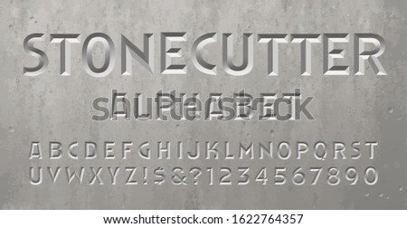 A beveled or chiseled font with the appearance of an inscription or epitaph on a gravestone, tomb, or mausoleum. Stonecutter alphabet perfect for spelling dates or a message on a headstone. Stock photo ©