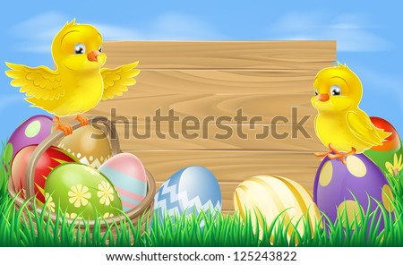 A blank wooden Easter egg sign with Easter eggs in a wooden hamper, chicks and copyspace