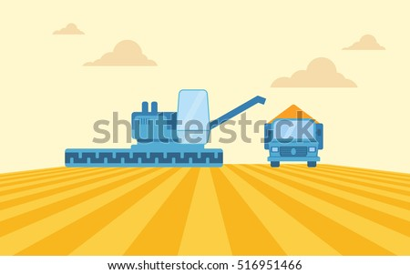 a blue harvesting combine and a