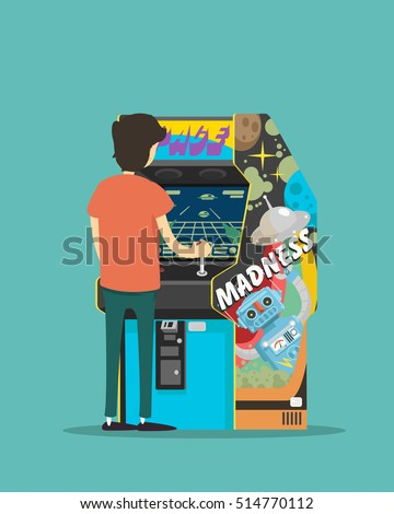 a boy play on a arcade machine