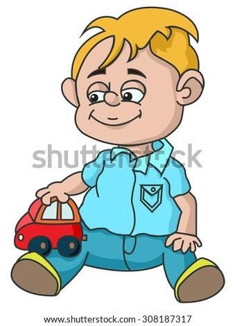 a boy with a toy car sitting on