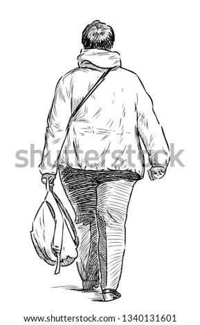 A casual urban dweller goes down the street