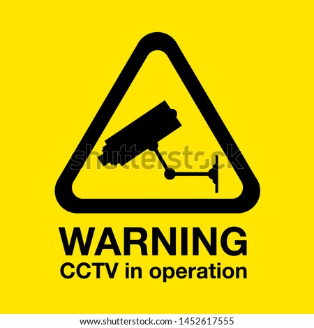 a Cctv in operation warning sign Foto stock ©