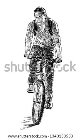 A city dweller ride a bicycle