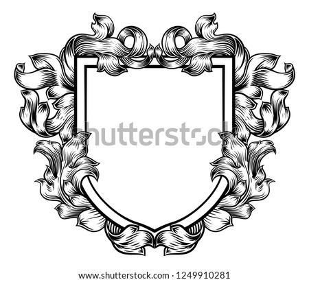 A coat of arms crest heraldic medieval knight or royal family shield. Vintage motif with filigree leaf heraldry. Foto d'archivio ©